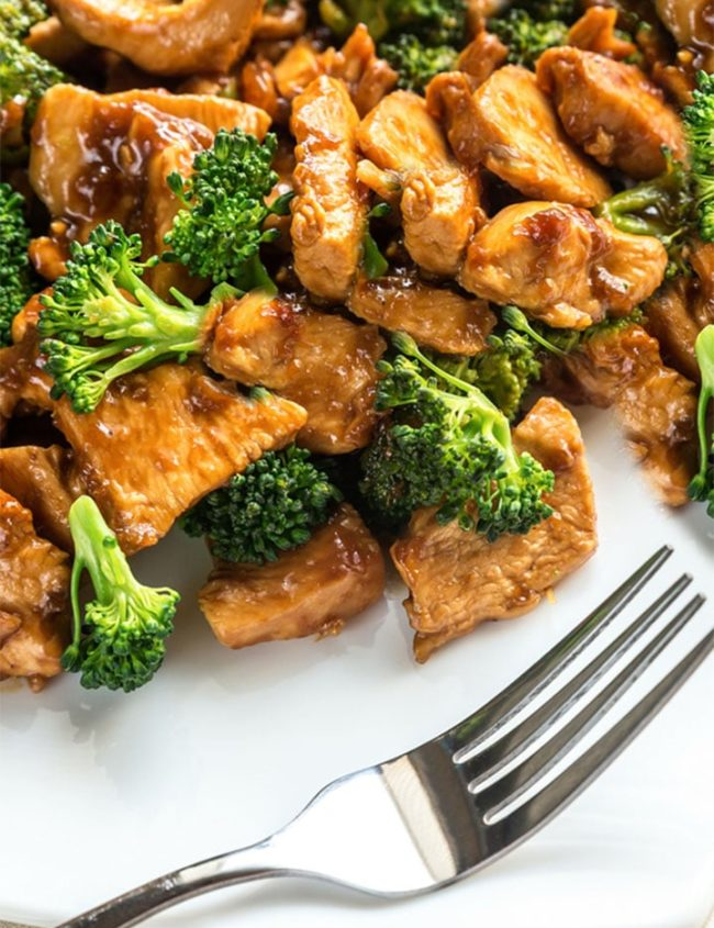 The plated Chinese Chicken & Broccoli ready to eat with a fork next to it