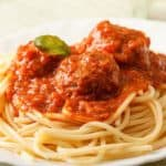 Cheaters Meatballs & Pasta on a plate garnished with herbs
