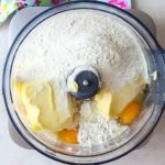 All of the cake ingredients added to a food processor bowl