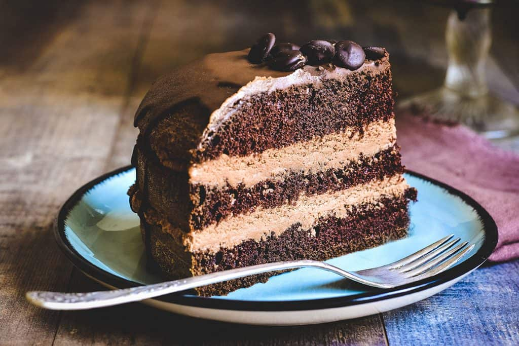 a slice of Chocolate cake with chocolate buttercream between the layers