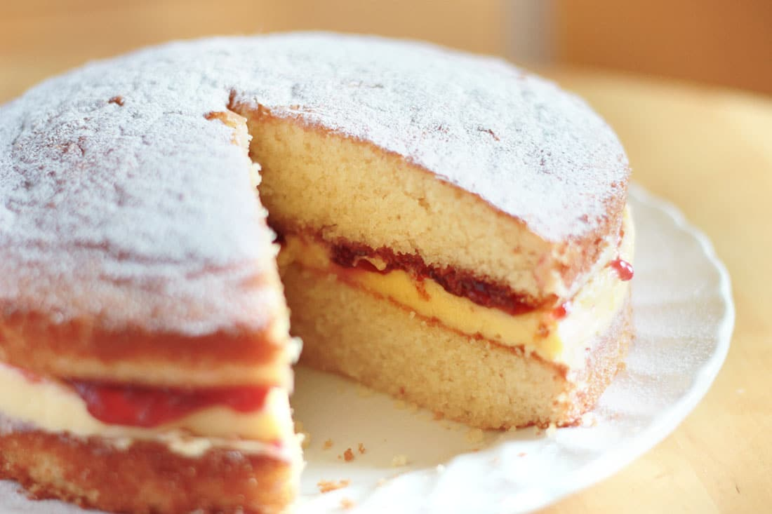 This simple Victoria Sponge Cake recipe from Erren's Kitchen has delicious a raspberry jam and butter cream filling that takes the classic Victoria sponge to a higher level.