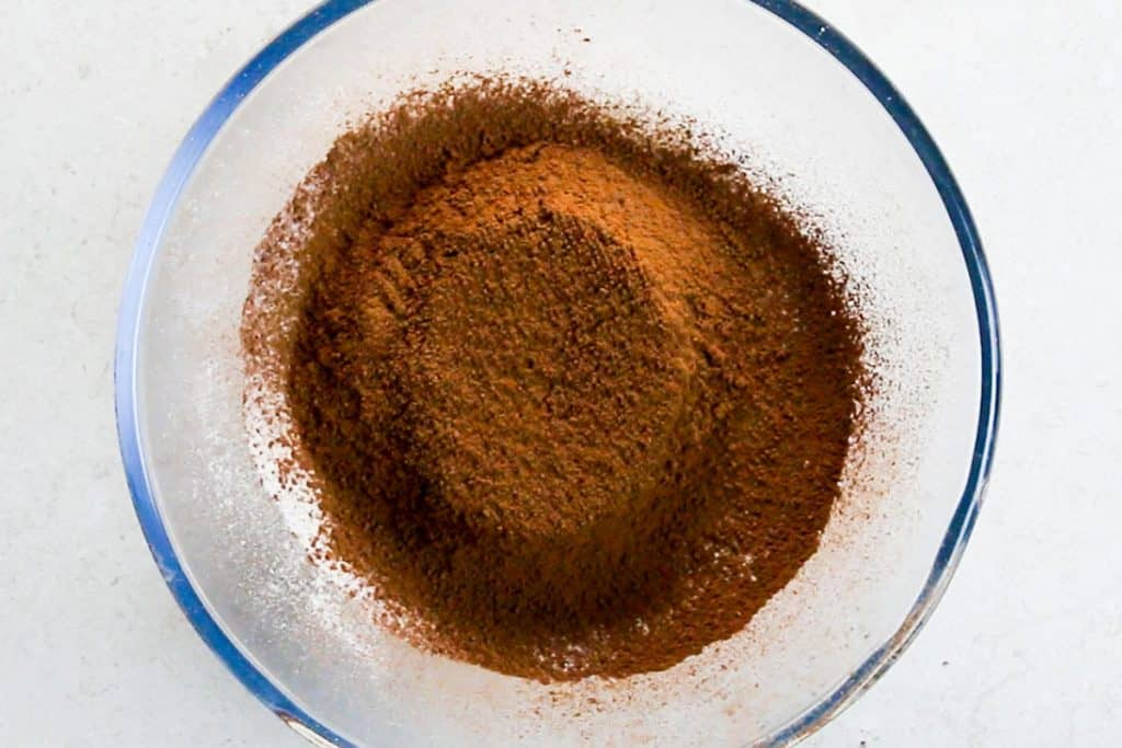 flour, cocoa powder, baking powder, and salt sifted in a bowl