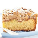 New Jersey Crumb Coffee Cake piled high with crumb topping and topped with powdered sugar