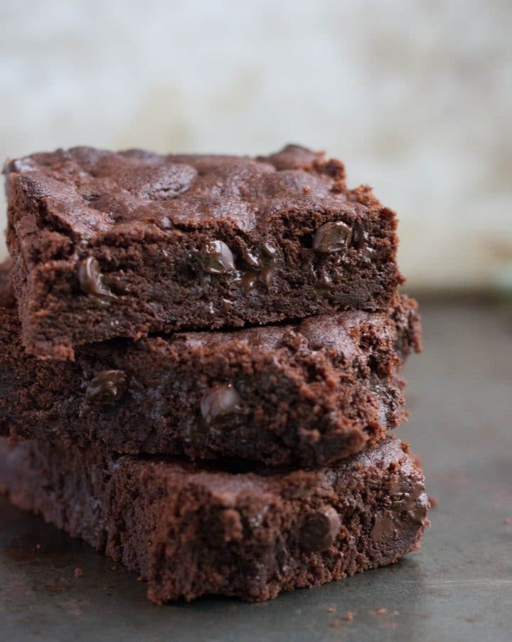 A close up double chocolate chips bars stacked on top of each other.