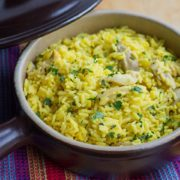 Easy One Pot Chicken and Saffron Rice in a serving dish, sprinkled with chopped parsley