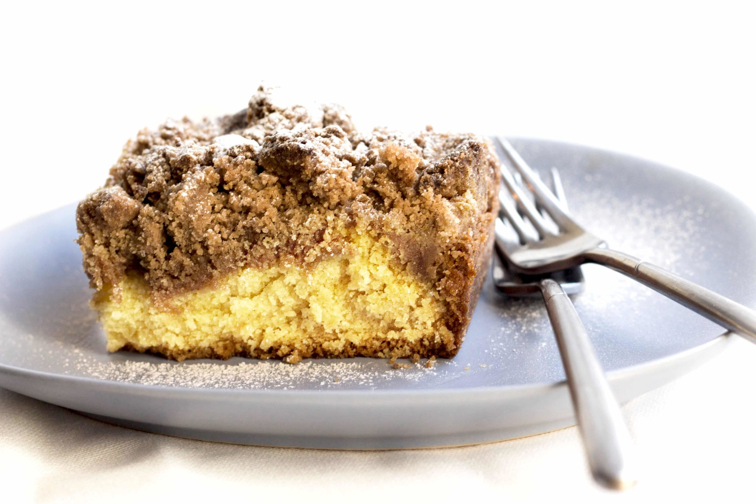 A slice of New Jersey crumb cake on a plate with two forks