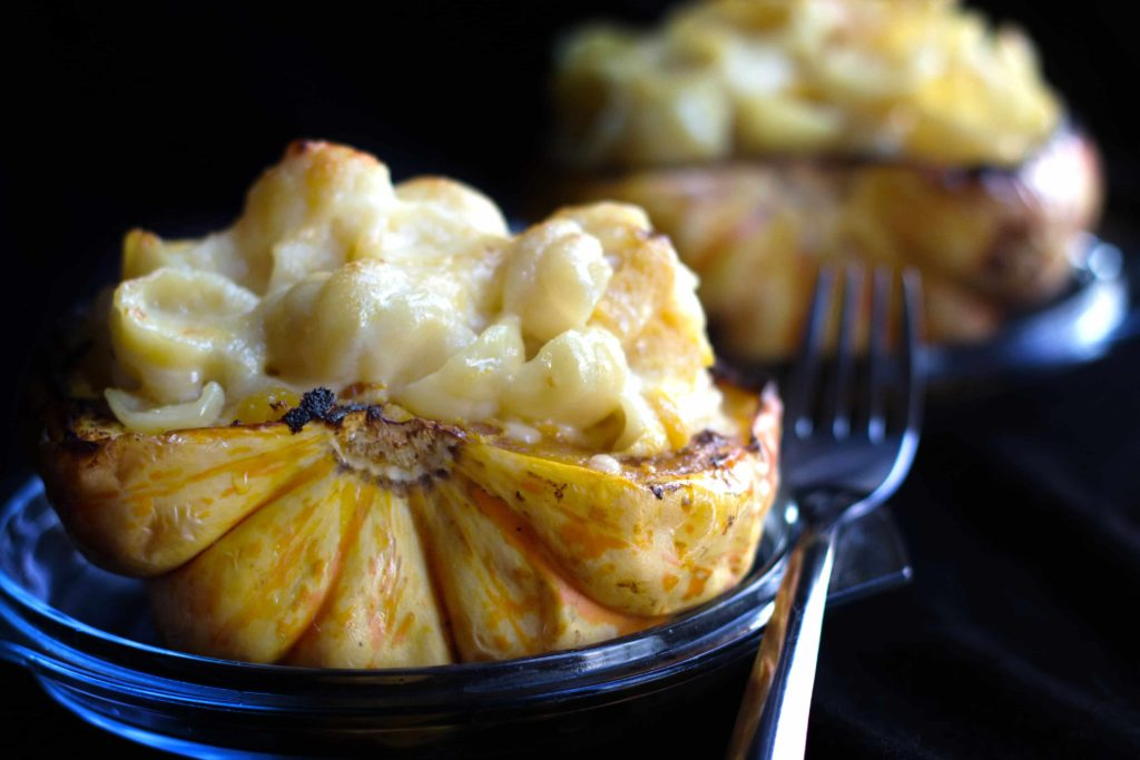 two cheesy pasta stuffed roasted squash ready to eat