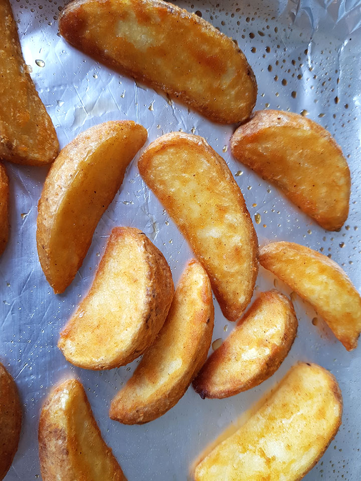 the Seasoned Baked Potato Wedges golden brown just out of the oven.