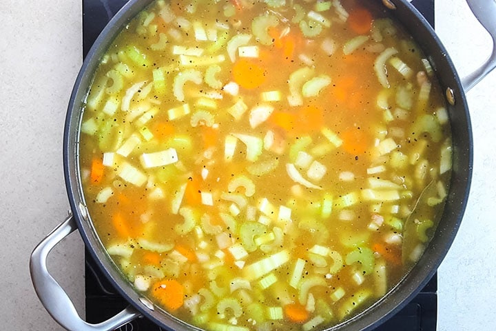 seasoning added to the soup in the pan