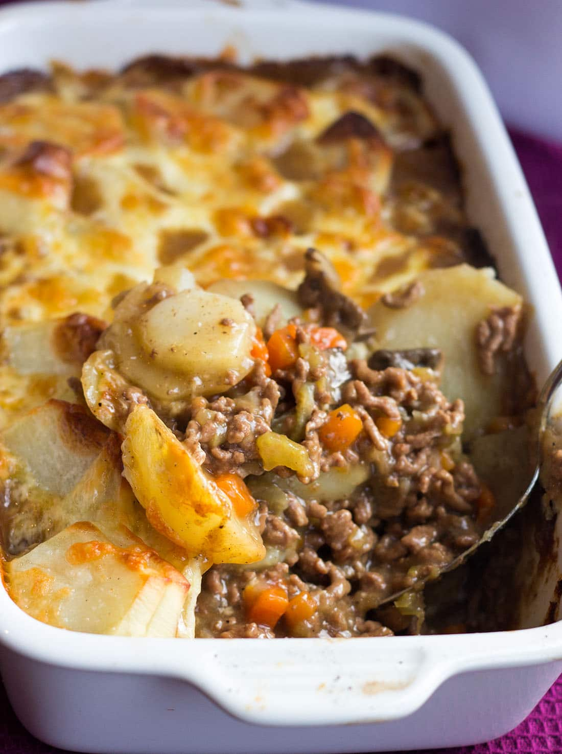 This recipe for Cottage Pie with a spoonful being taken out.