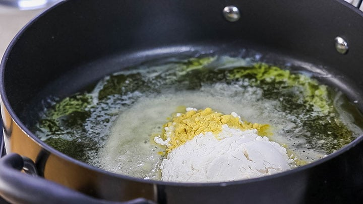 The flour and mustard powder added to the pan with the butter