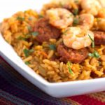 Shrimp and Chorizo on top of saffron rice
