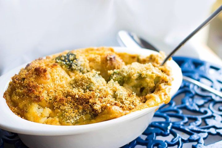 A casserole dish with the Cheesy Broccoli and Cauliflower Baked with a golden crumb topping