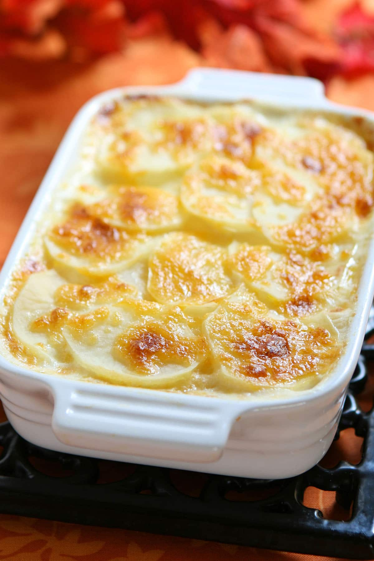 Cheesy Scalloped Potatoes in serving dish fresh from the oven