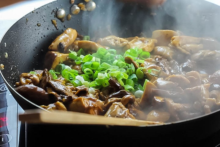The green onions added to the wok with the Chicken and Chinese Mushrooms