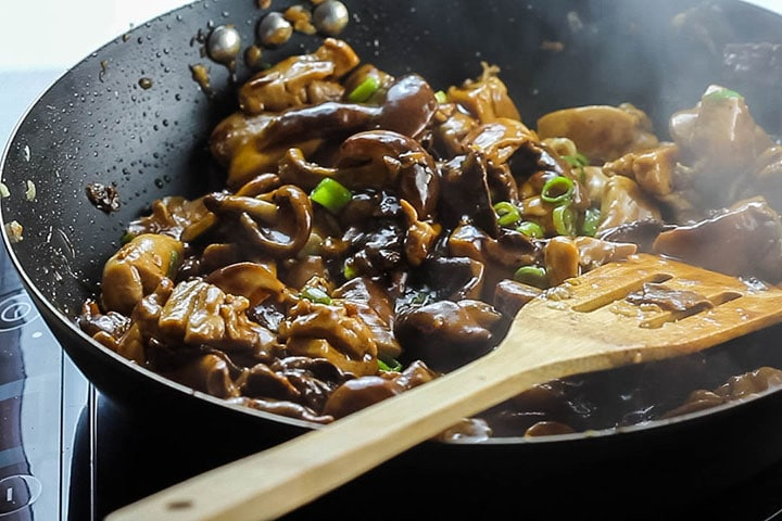 Chicken and Chinese Mushrooms cooked in the wok ready to serve