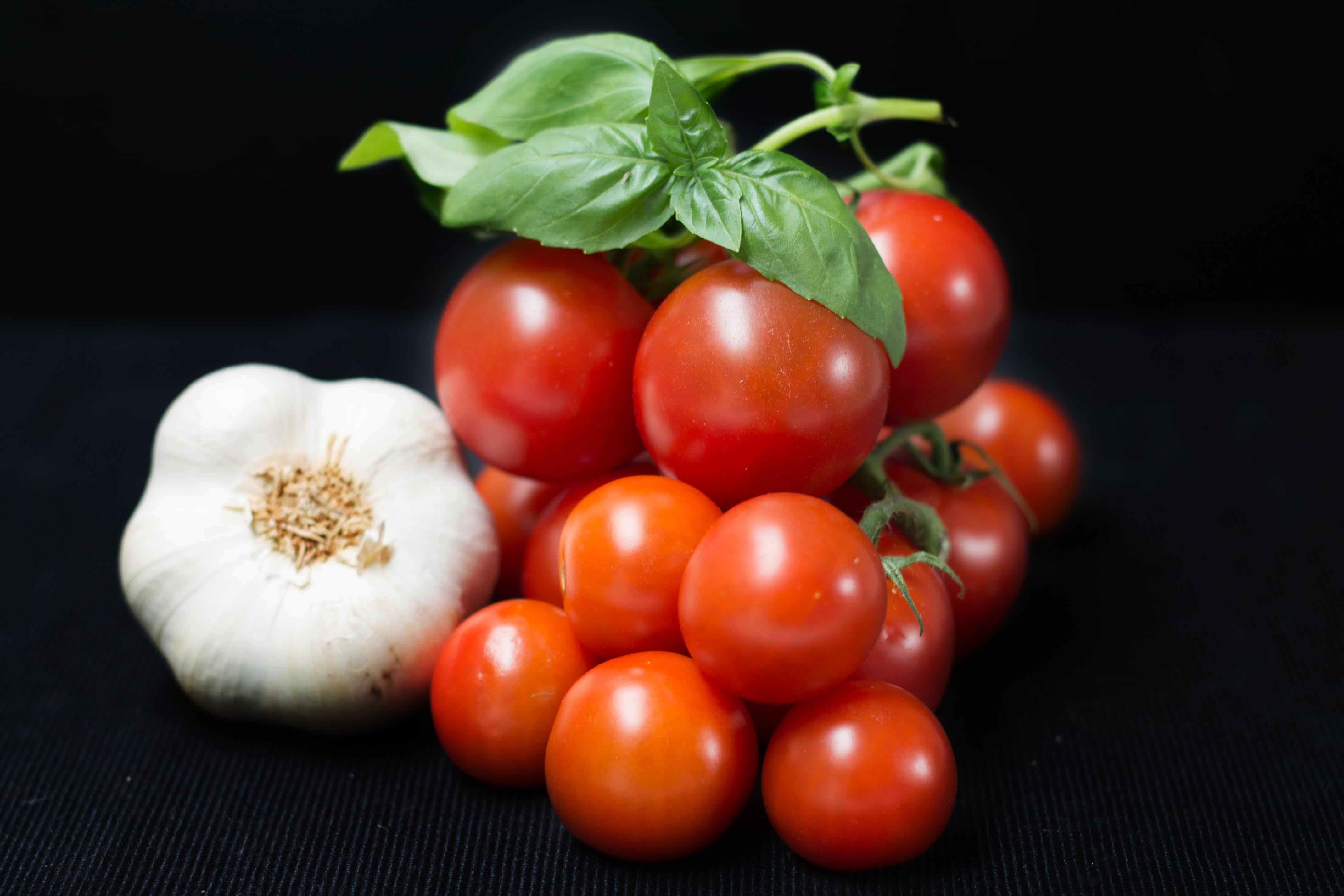 garlic bulb, cherry tomatoes and basil
