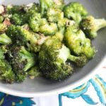 The roasted broccoli sprinkled with Parmesan cheese.