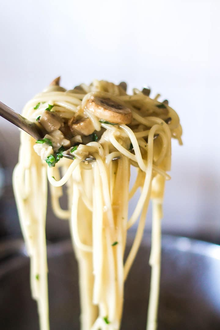 A spaghetti scoop filled with the Creamy Mushroom Spaghetti