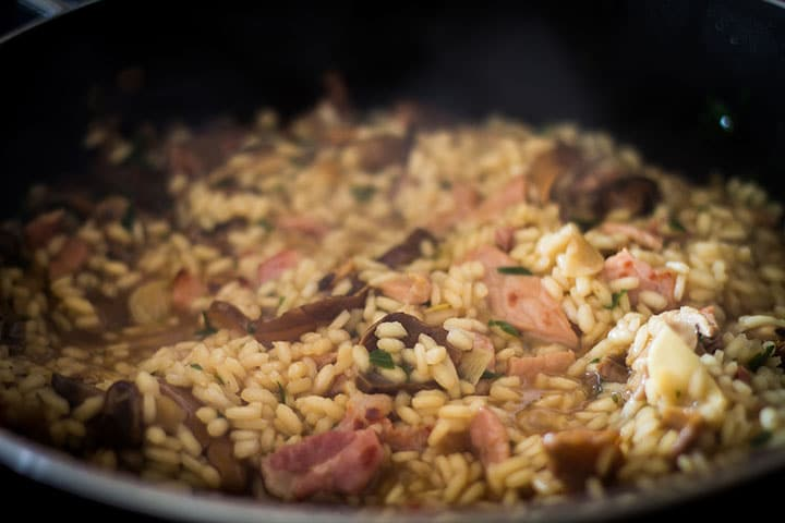 the Easy Mushroom & Bacon Risotto cooked in the pan