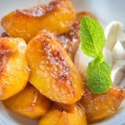 peaches and cream served with a sprig of mint for decoration