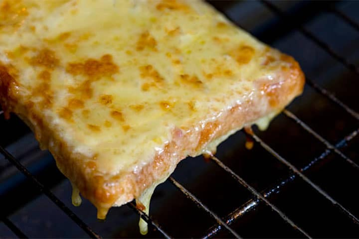 Cheese melted on toast in a rack