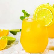 citrus punch in a class with sliced lemon and mint garnish