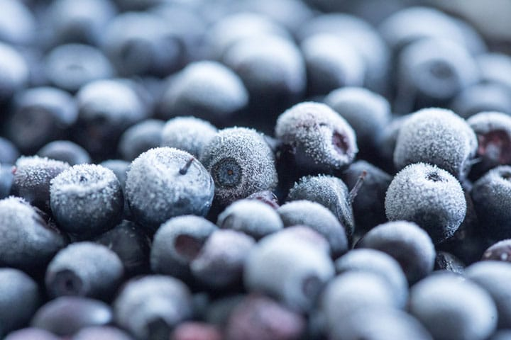 A close up of frozen blueberries