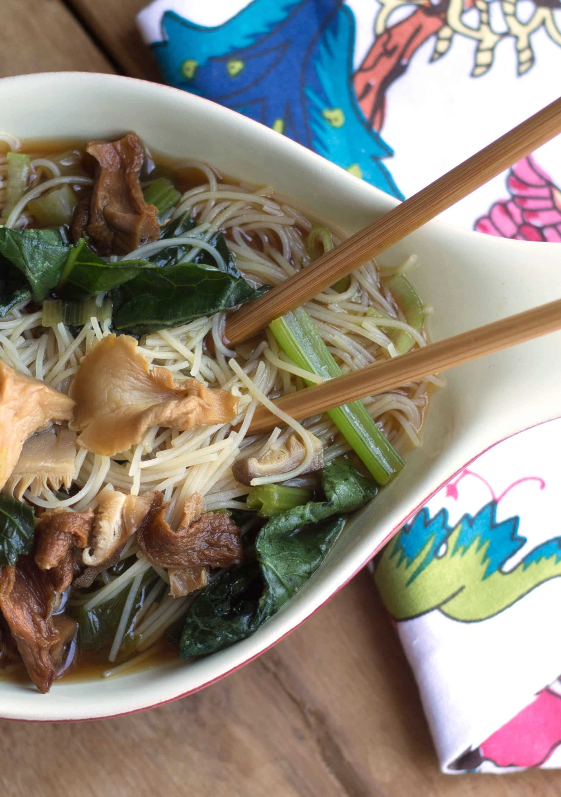 Chinese mushroom noodle soup with chopsticks