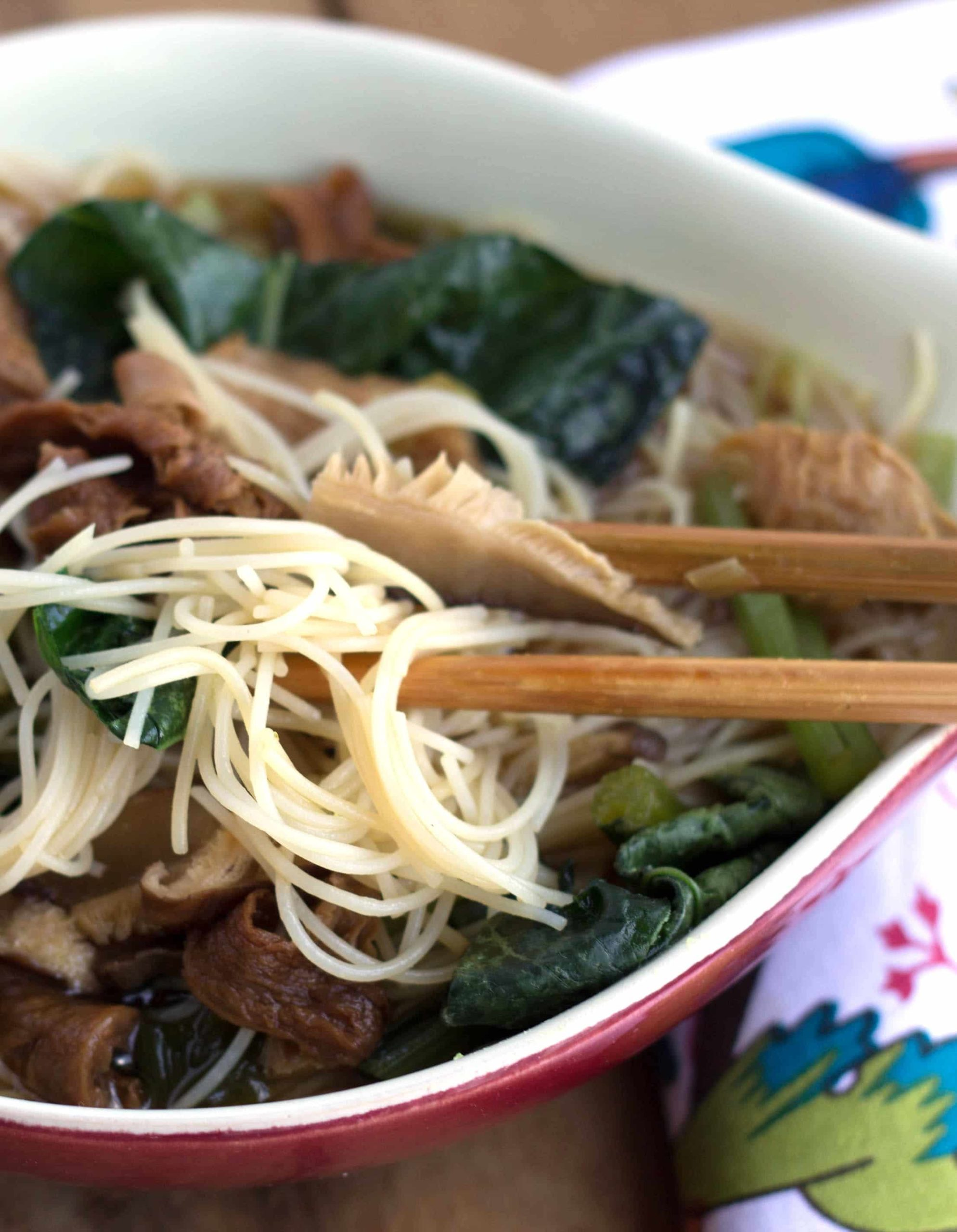 close up of Chinese mushroom noodle soup with chopsticks