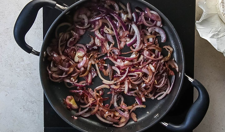 cooked red onions in a pan
