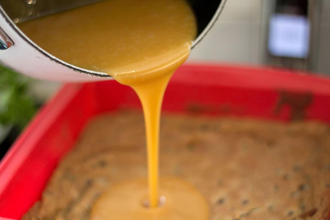 Salted Caramel being poured onto the cooled base