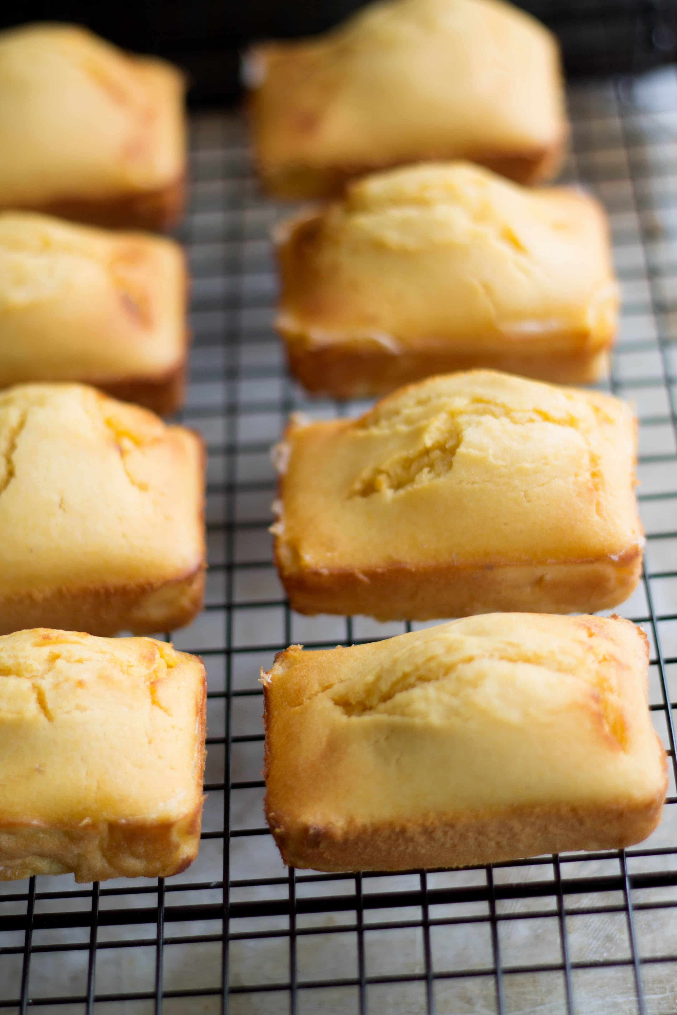 Mini Honey Cornbread loaves cooling on a wire rack