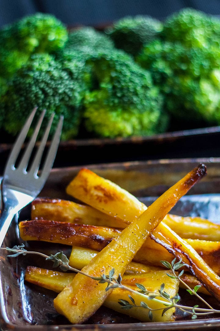 Honey & Maple Roasted Parsnips on a serving dish ready to eat