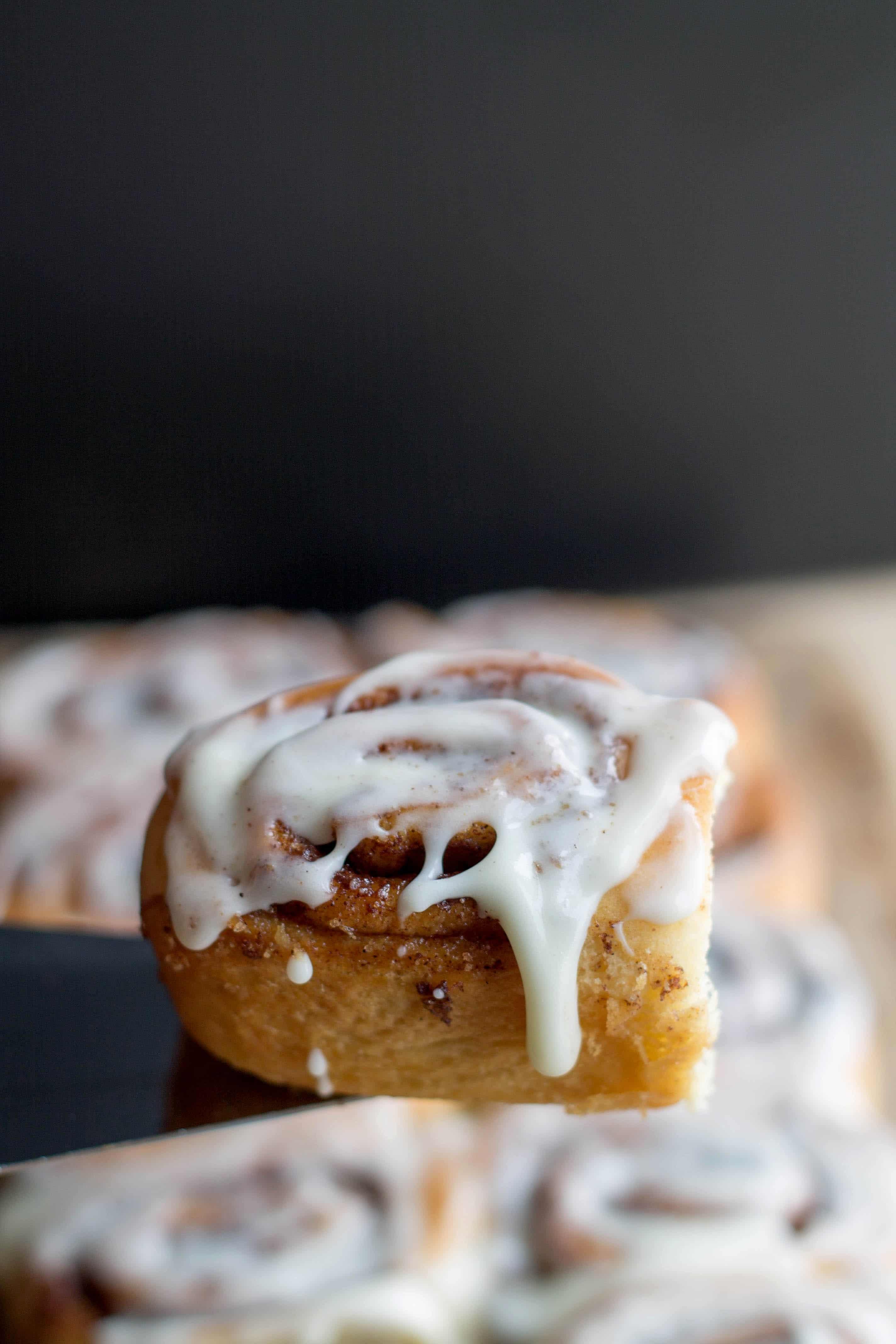 A close up of a cinnamon bun on a cake slice