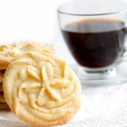 A cup of coffee on a table, with Cookie and Shortbread