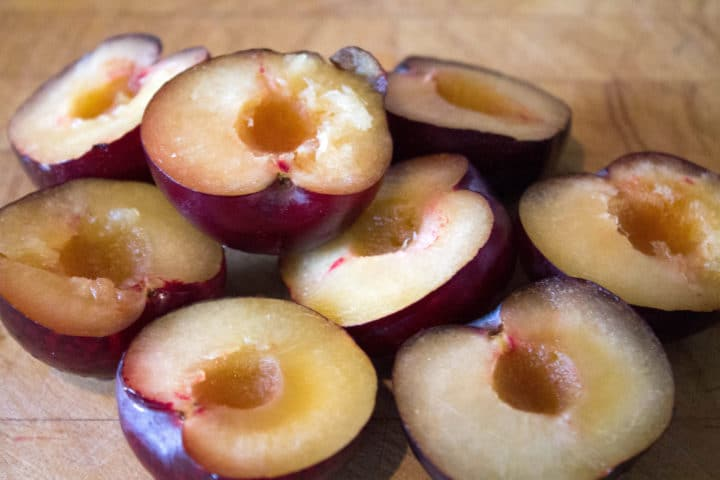 plums cut in half with the stones removed