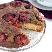 plum upside-down cake with a slice taken out