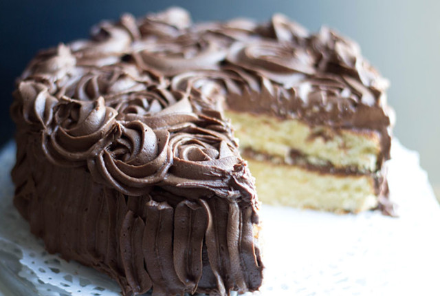 Rich Vanilla Cake with Chocolate Fudge Icing - Erren's Kitchen - You can't go wrong with this classic party cake. Every bite will bring a taste of nostalgia.