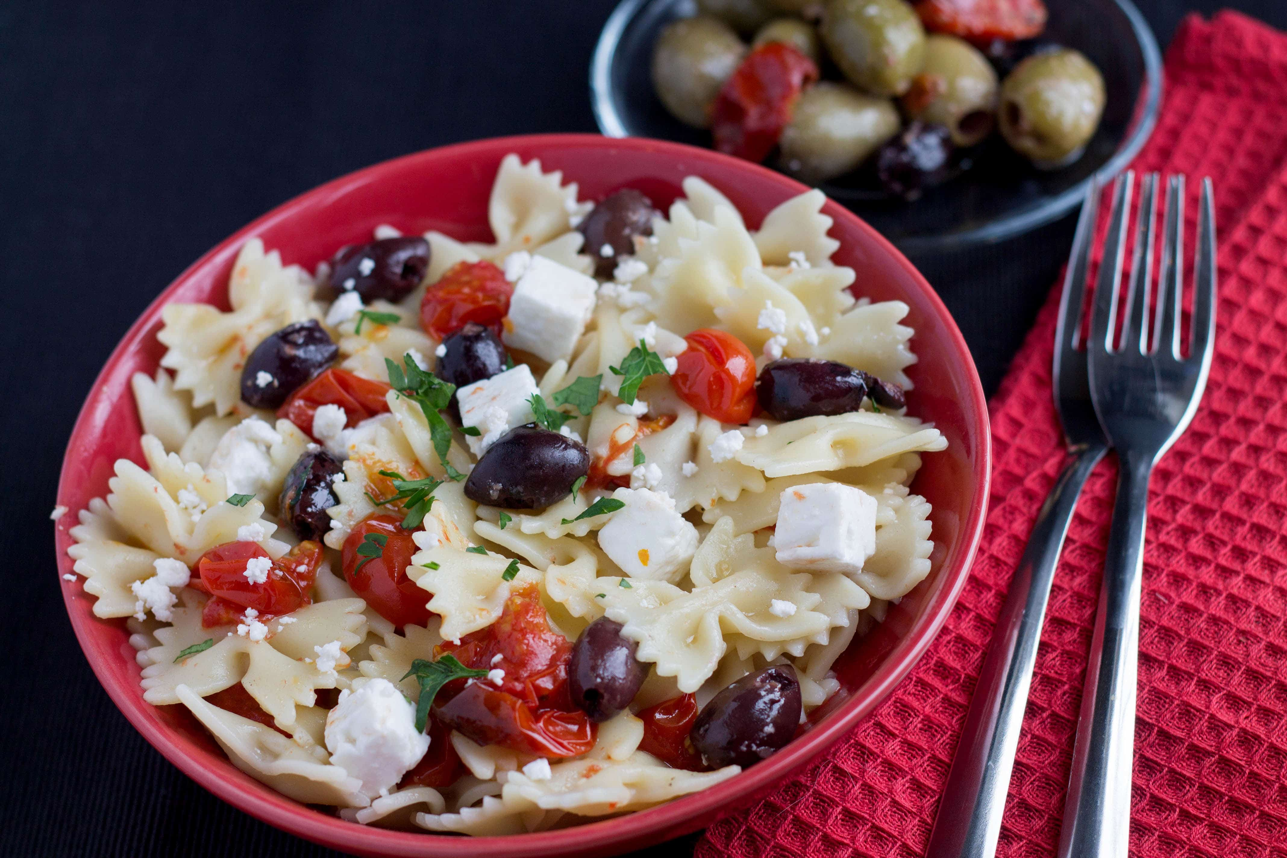 Quick & Easy Pasta with Tomatoes, Feta & Olives - This dish brings big flavor with sweet roasted tomatoes that are the perfect contrast to the saltiness of the feta & olives!