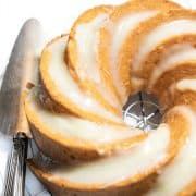 Bundt Cake with Cream Cheese Icing on acooling rack