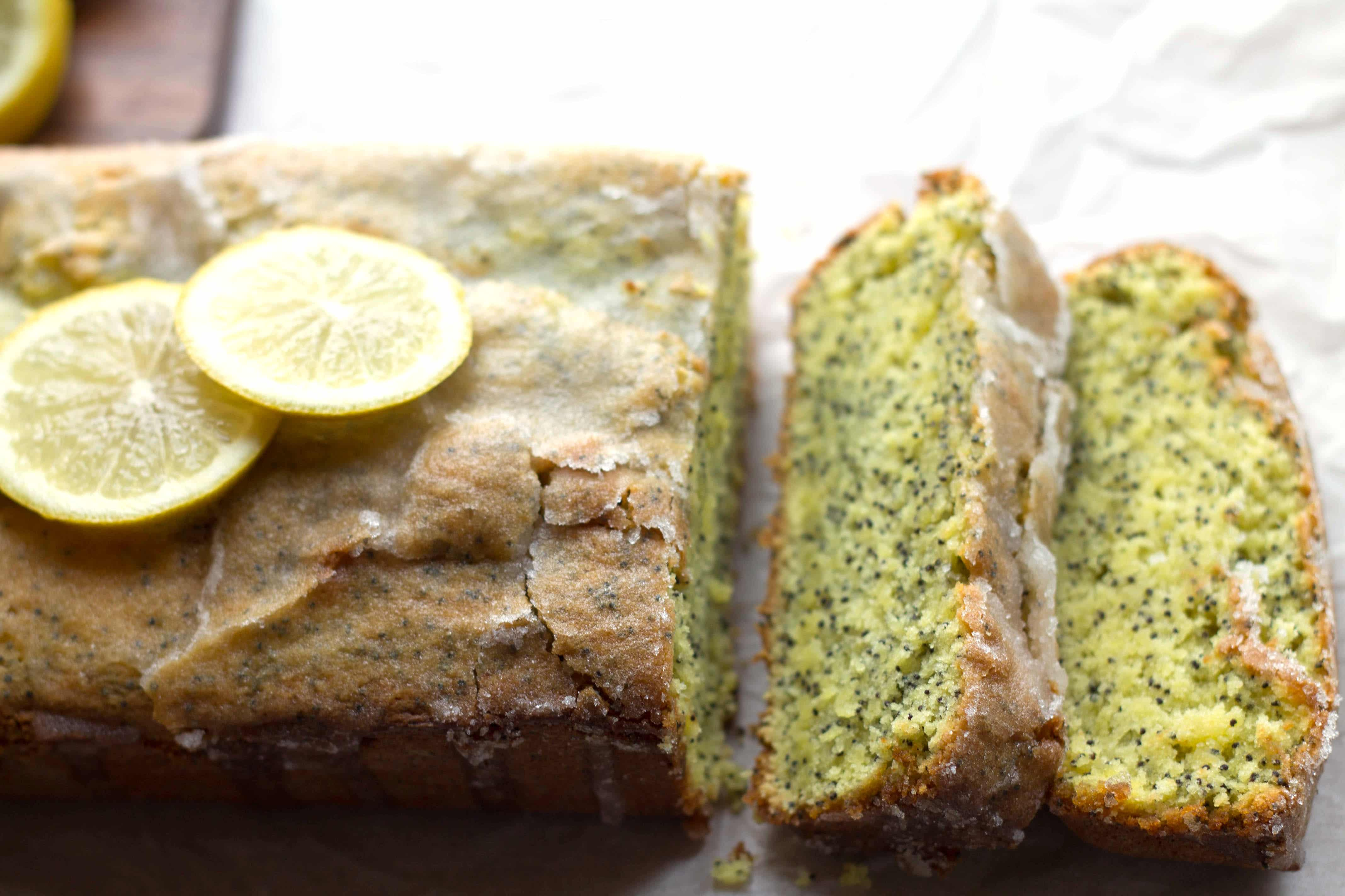 Lemon Poppy Seed Drizzle Cake - Erren's Kitchen - Lemon Drizzle Cake is a classic English recipe. Poppy seeds add a bit of a twist to this classic citrus cake with a crunchy sugar topping and moist texture.