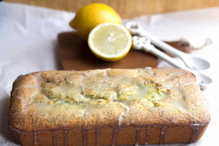 The baked lemon poppy seed loaf cake with the set glaze.