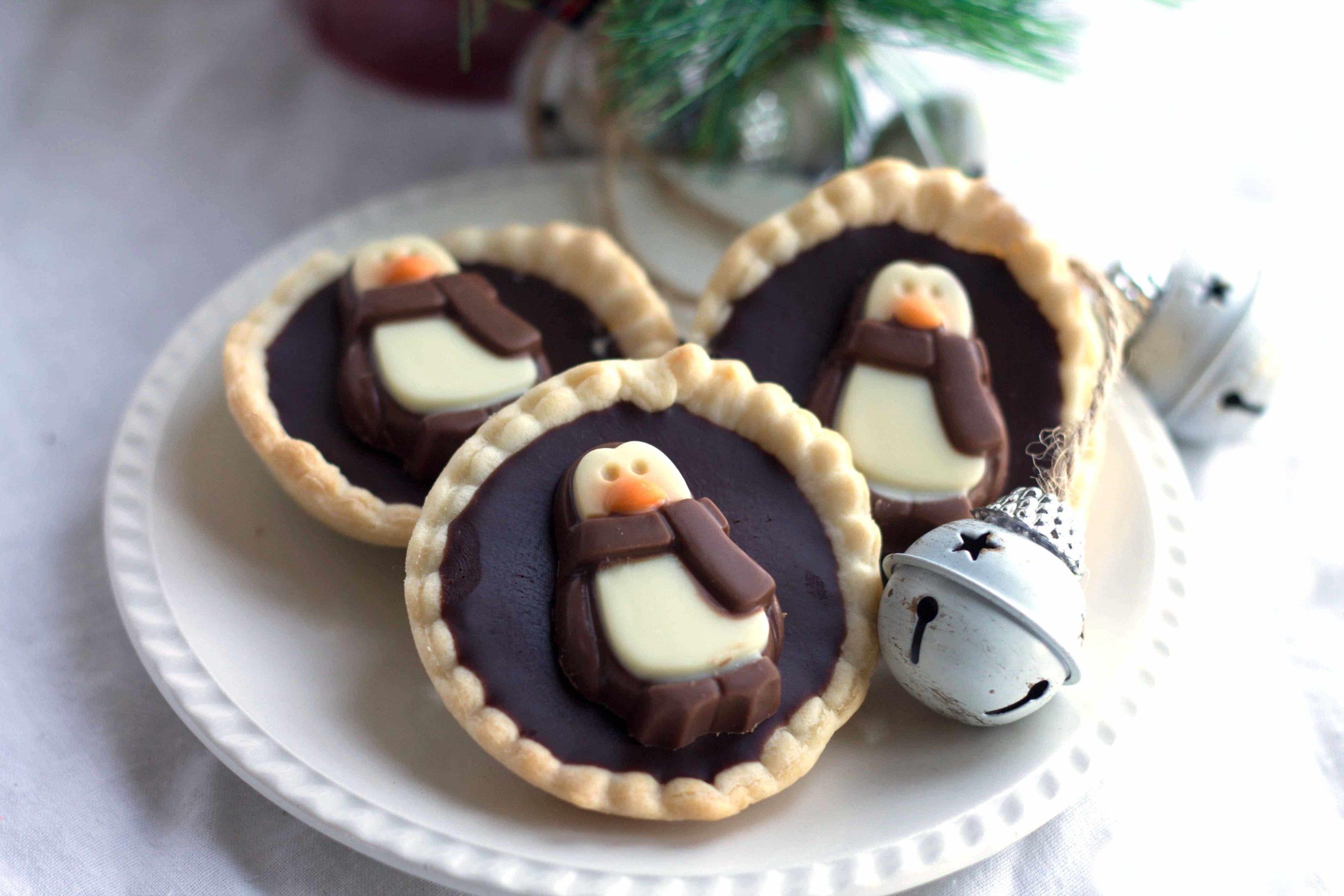 dark chocolate ganache tarts decorated with chocolate penguins