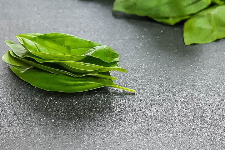 basil leaves stacked on top of each other.