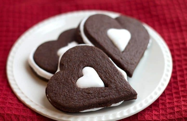 Three heart shaped Chocolate Marshmallow Sandwich Cookies on a plate