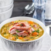 A bowl of vibrant, Split Pea and Ham Soup topped with shredded ham