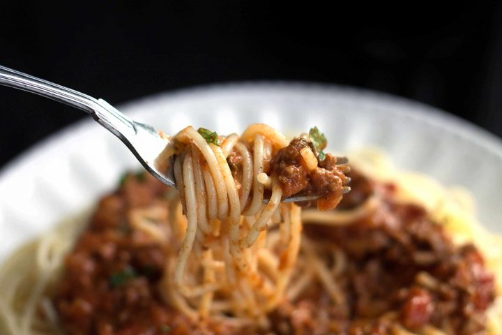 A forkful of Quick & Easy Spaghetti Bolognese ready to eat
