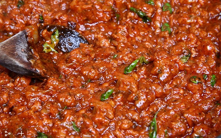 A pan close up of the Quick & Easy Spaghetti Bolognese with the herbs added