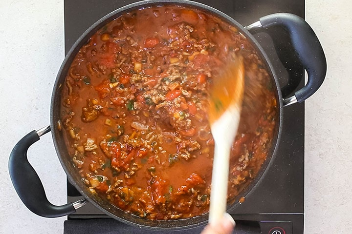 A pot full of the cooked Quick & Easy Spaghetti Bolognese ready to serve